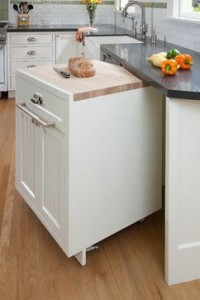 Gotta love this moveable island that tucks under the countertop. and it has a cutting board on top