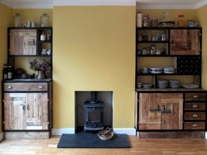 Made using reclaimed victorian floorboards, reeded glass sliding doors and a brightly painted backing pane kitchen ideas gallery