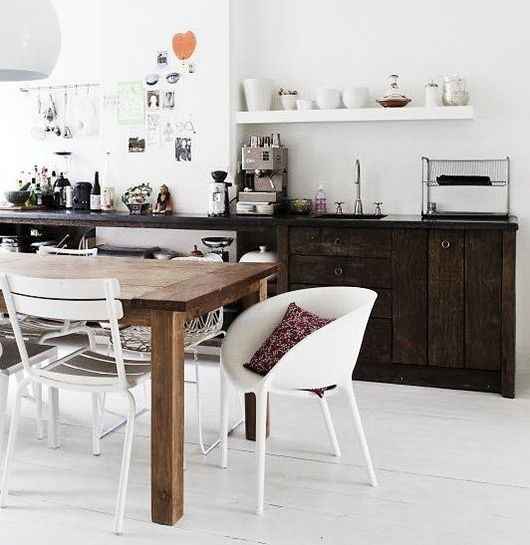 Design of the white wooden white kitchen without upper cabinets